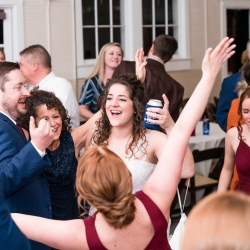 Bride having a great time on the dance floor to music provided by AAA Entertainment during her wedding at The Diary Barn