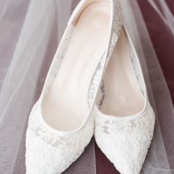 Jenny Williams Photography captures the details of bridal shoes and veil during a fall wedding in Fort Mill. SC