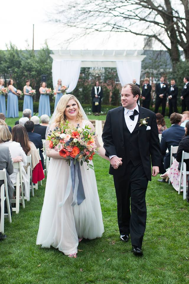 Bride and groom recessional after wedding ceremony at Separk Mansion coordinated by Magnificent Moments Weddings