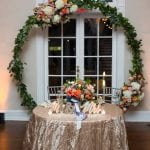 Sweetheart table at Separk Mansion wedding reception with amazing floral backdrop by What's Up Buttercup