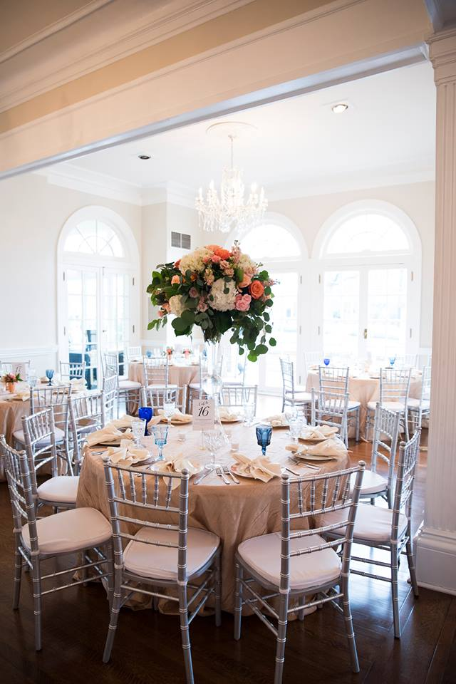 Reception space at Separk Mansion with rentals from Evermore and stunning floral centerpieces designed by What's Up Buttercup