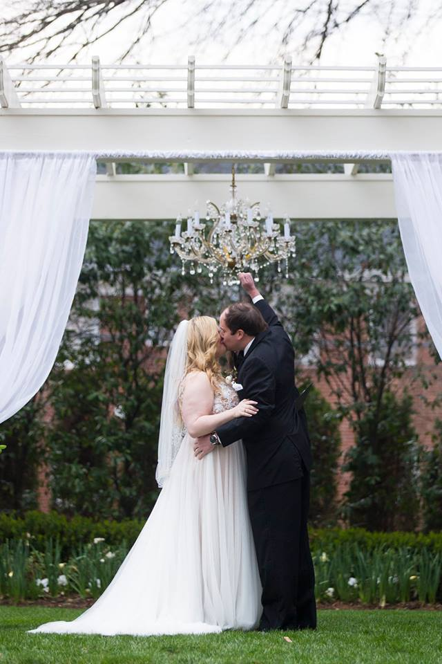 Bride and groom sharing first kiss after a wedding ceremony at Separk Mansion coordinated by Magnificent Moments Weddings