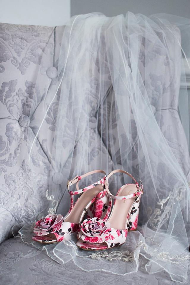 Detail shot of floral bridal shows and lace detail veil captured by Soussou Productions