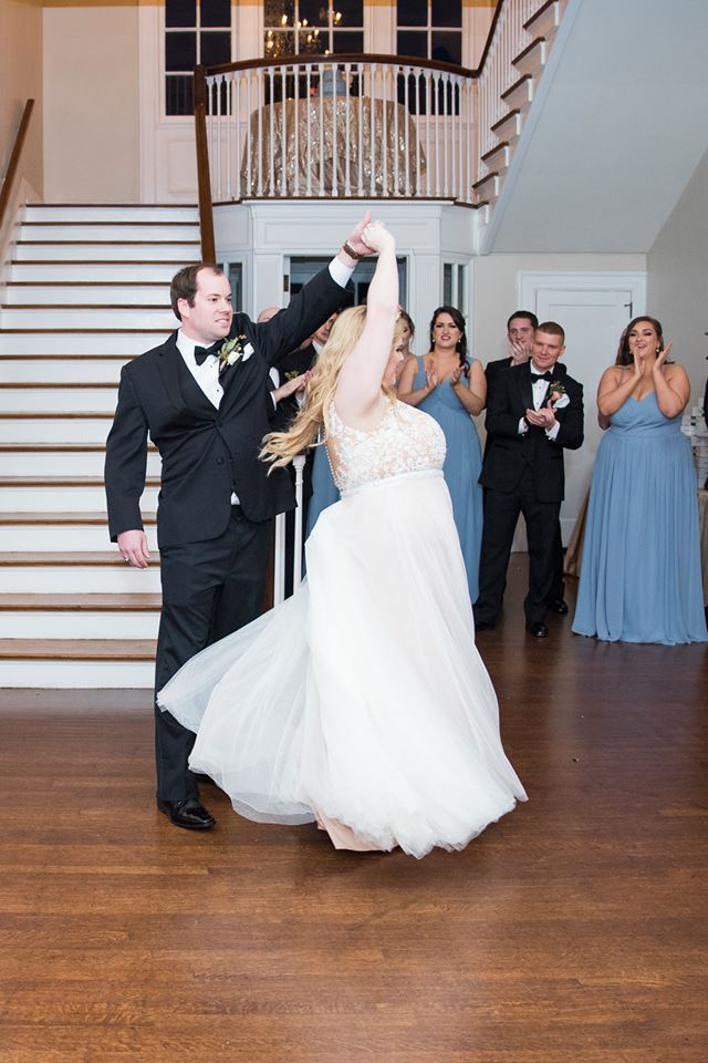 Bride and groom share a first dance at their Separk Mansion wedding reception with music provided by Split Second Sound