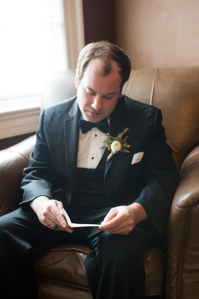 Groom reading note for his bride before their ceremony at Separk Mansion coordinated by Magnificent Moments Weddings