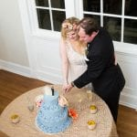 Bride and groom cut amazing blue cake from Publix bakery at a wedding reception at Separk Mansion