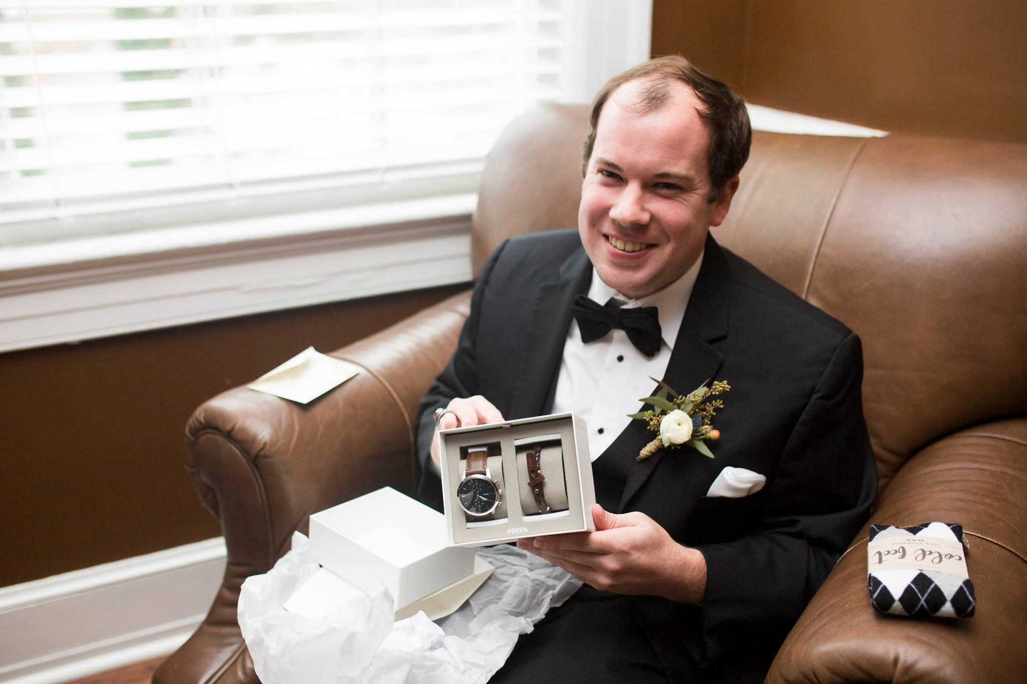 Groom showing of gift before wedding at Separk Mansion