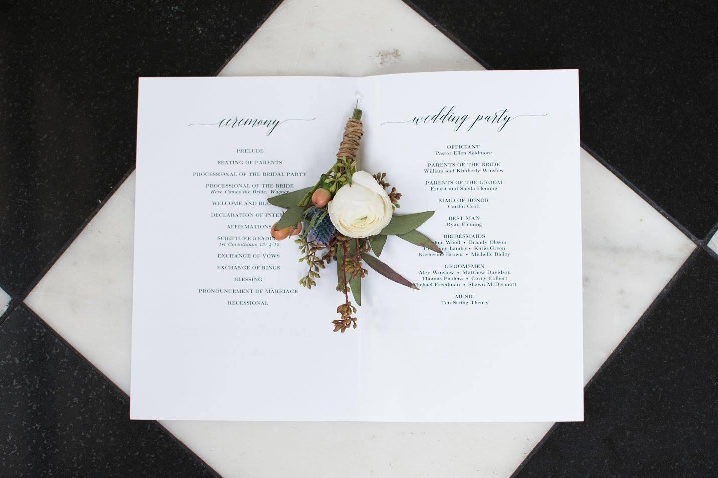 Detail shot of wedding ceremony program captured by Soussou Productions