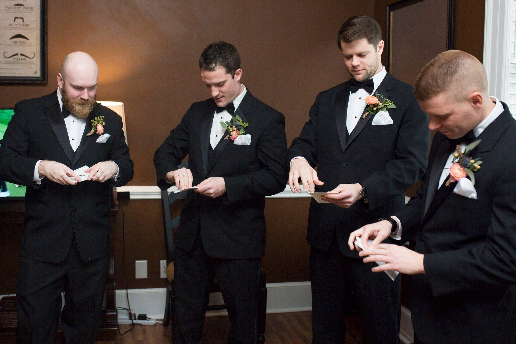 Groomsmen opening thank you cards before wedding ceremony at Separk Mansion captured by Soussou Productions