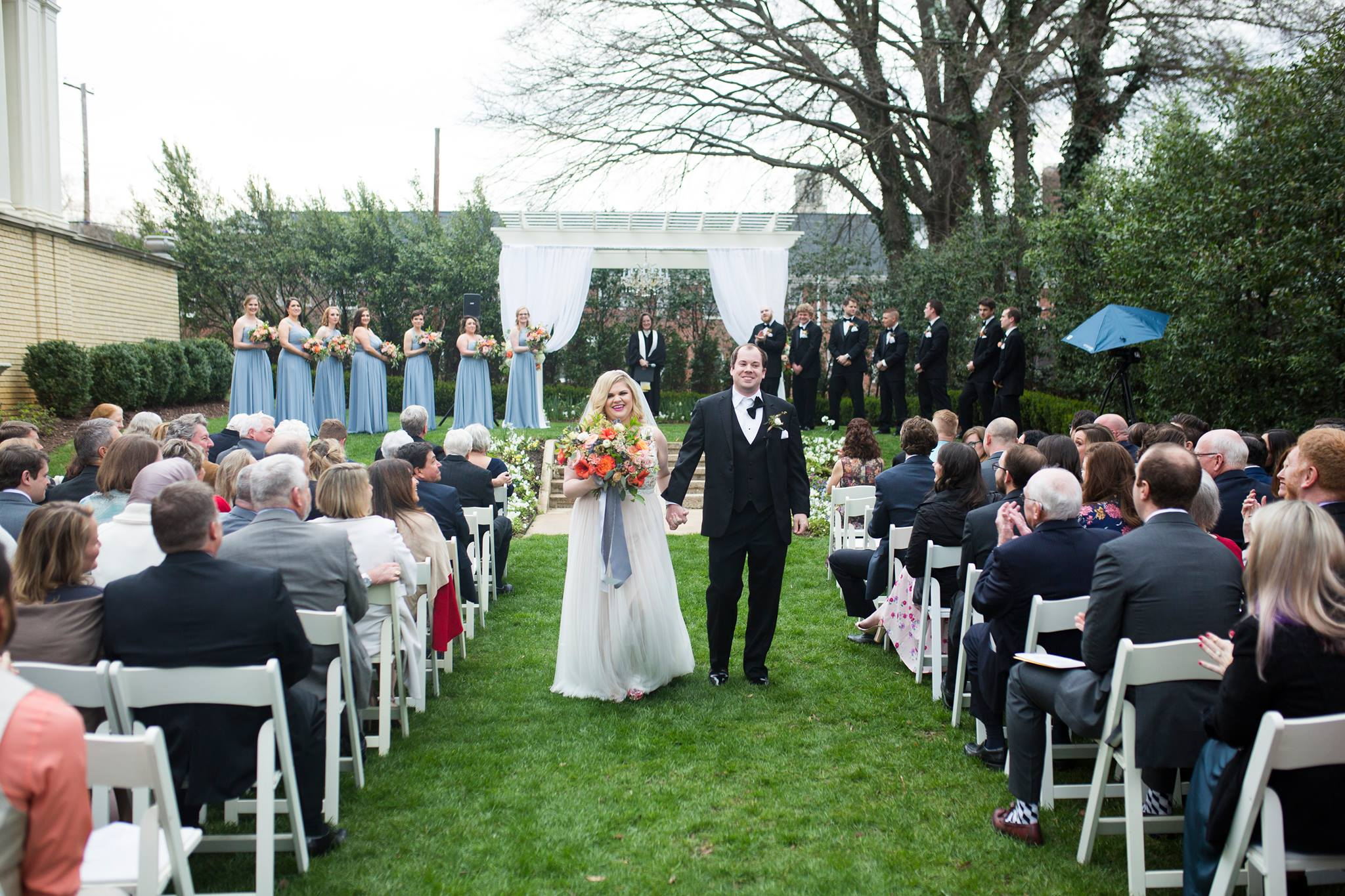 Bride and groom recess from wedding ceremony at Separk Mansion coordinated by Magnificent Moments Weddings