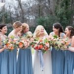 Bride with bridesmaids in pale blue dresses posing for a wedding a the Separk Mansion captured by Soussou Productions