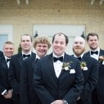 Groom posing with groomsmen at Separk Mansion wedding coordinated by Magnificent Moments Weddings