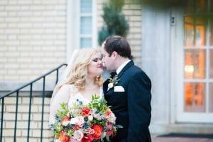 Bride and groom embrace after wedding ceremony at Separk Mansion coordinated by Magnificent Moments Weddings