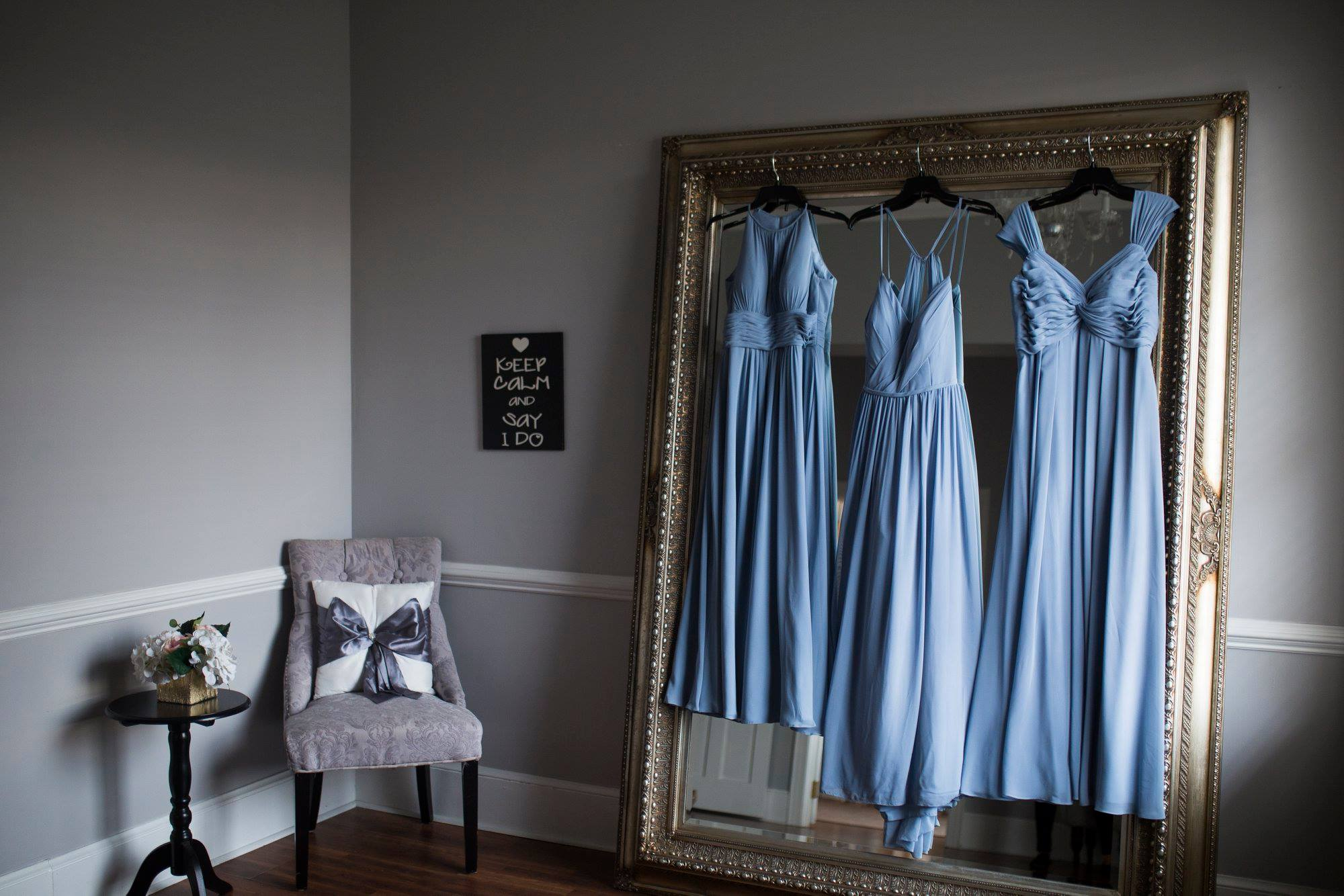 Stunning pale blue bridesmaids gowns hanging as bridal party prepare for Separk Mansion Wedding