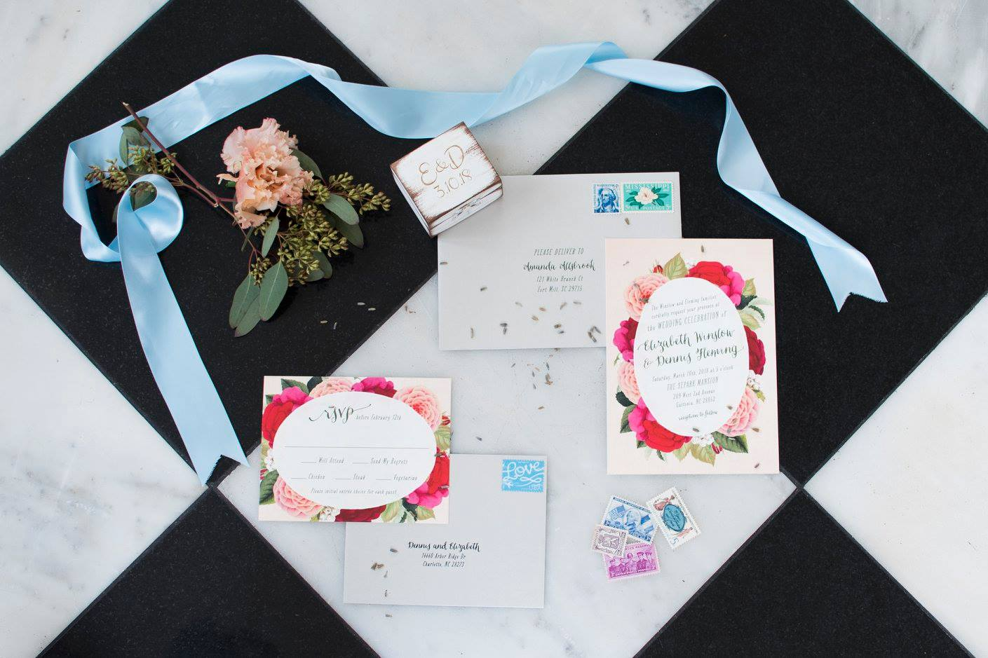 Detail shot of wedding invitation suite with amazing pink floral details captured by Soussou Productions