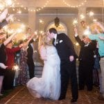 Bride and groom grande exit through sparklers from a wedding reception coordinated by Magnificent Moments Weddings