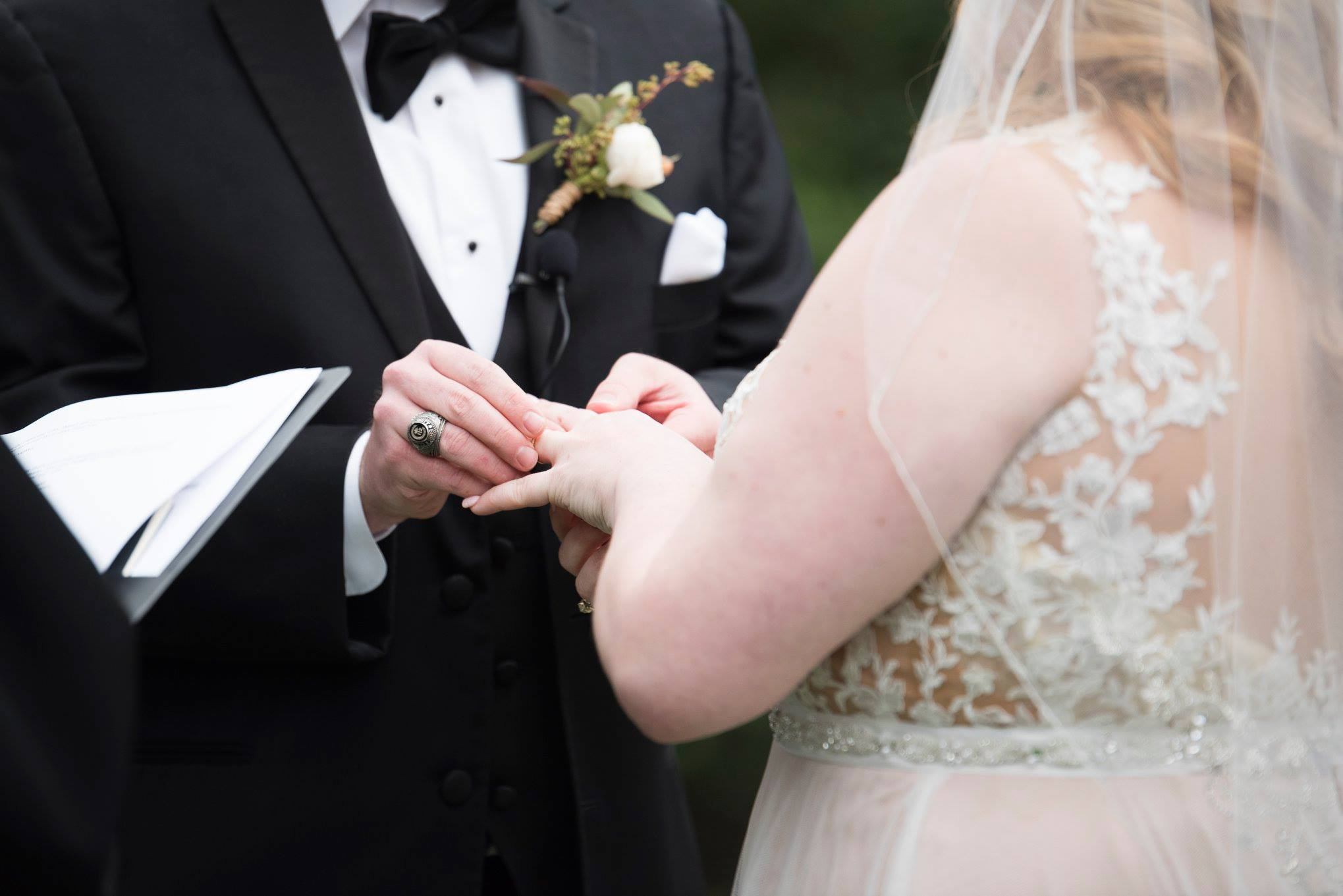 Bride and groom exchanging rings at a ceremony at Separk Mansion