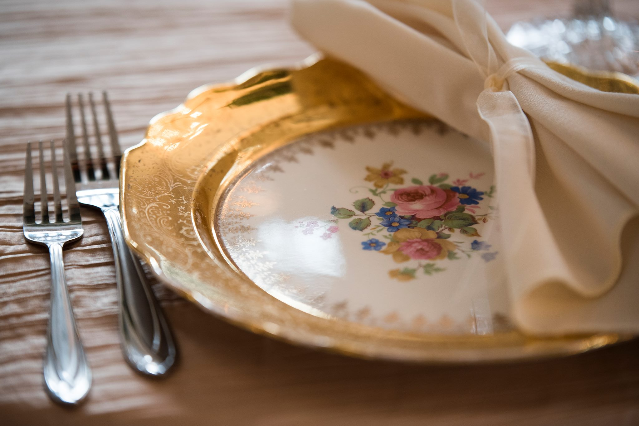 Vintage place setting from Evermore for wedding at Separk Mansion