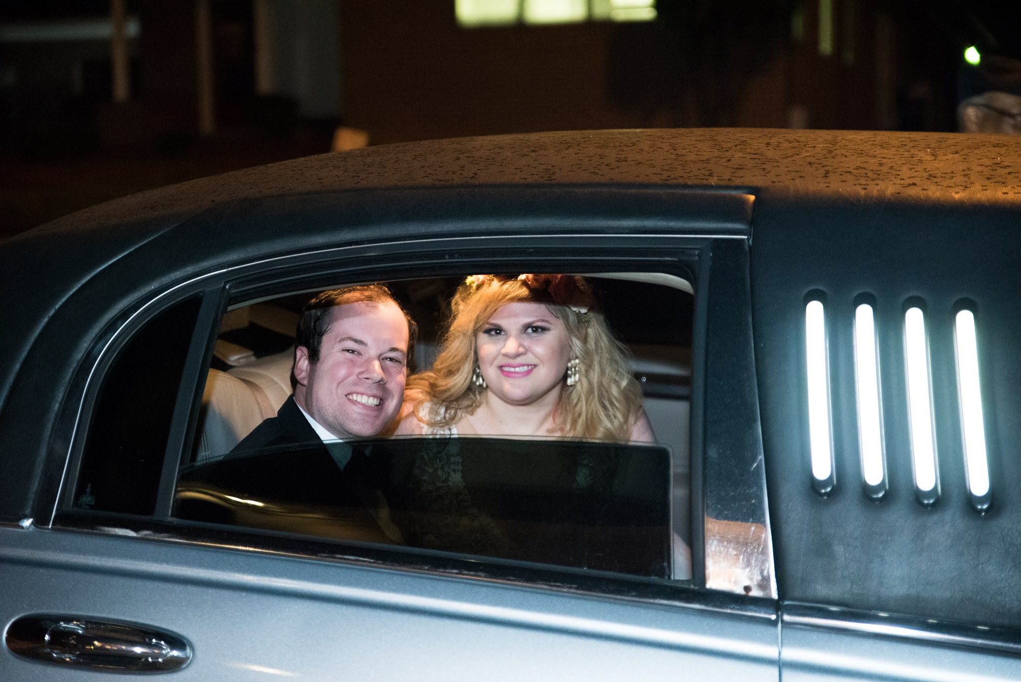 Bride and groom departing from their wedding at Spark Mansion in a Royal Limo