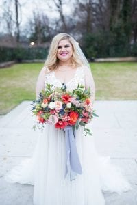 Bride holding stunning pink and blue bridal bouquet for Separk Mansion wedding coordinated by Magnificent Moments Weddings