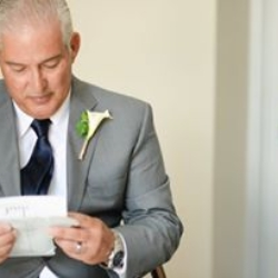 father of the bride reading a letter