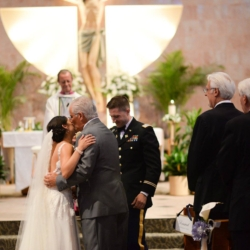 father of the bride kissing his daughter on the cheek