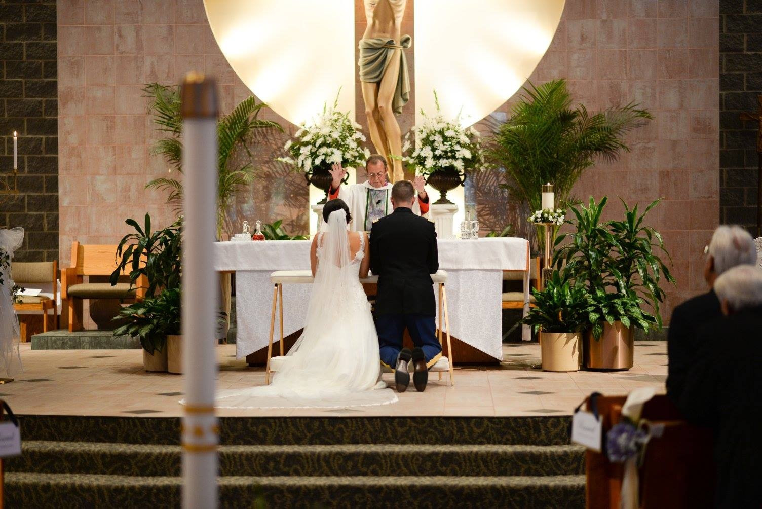 bride and groom at the altar in St. Matthew Catholic Church in Charlotte NC
