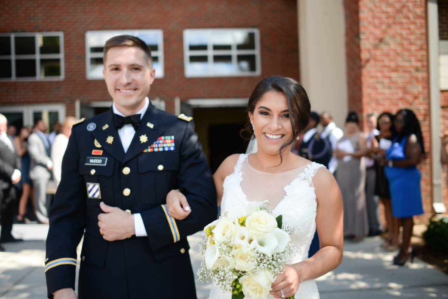 bride and groom exiting St. Matthew Catholic Church