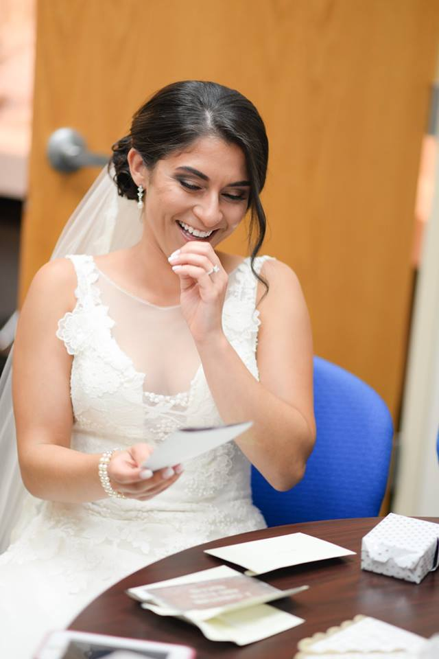 bride laughing in her bridal suite