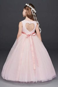 Large tulle skirt flower girl dress with charming heart cut out detail