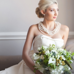 Bridal portrait of bride with large white bridal bouquet by Chelish Moore