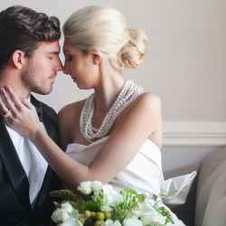 Bride embraces groom at Separk Mansion wedding wearing stunning gown from Paige and Elliot