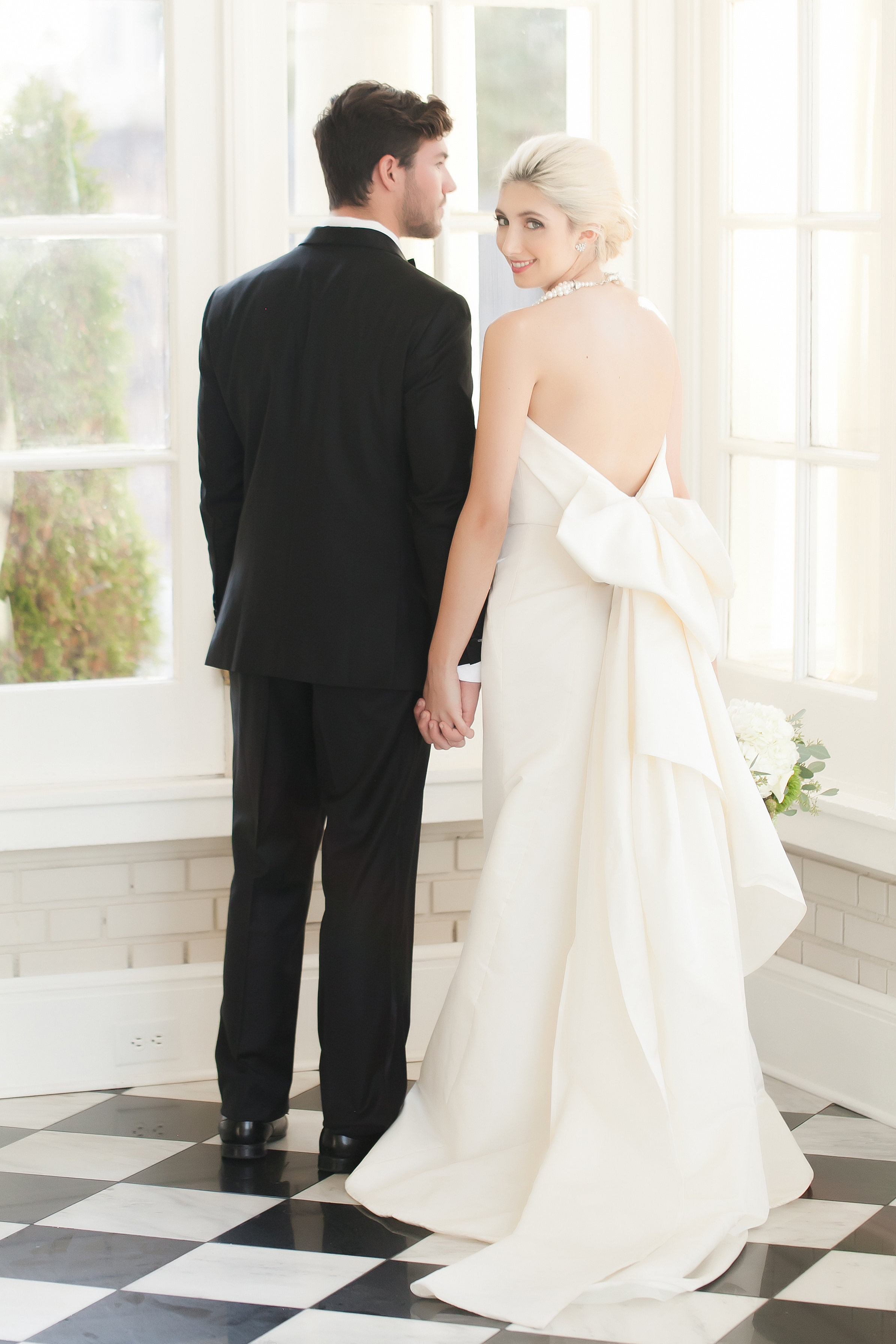 Bride and groom pose for pictured captured by Casey Hendrickson Photography during their wedding at the Separk Mansion
