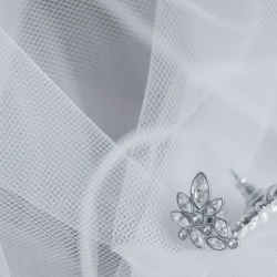 Detail shot of stunning bridal jewelry for a styled shoot at Separk Mansion designed by Magnificent Moments Weddings