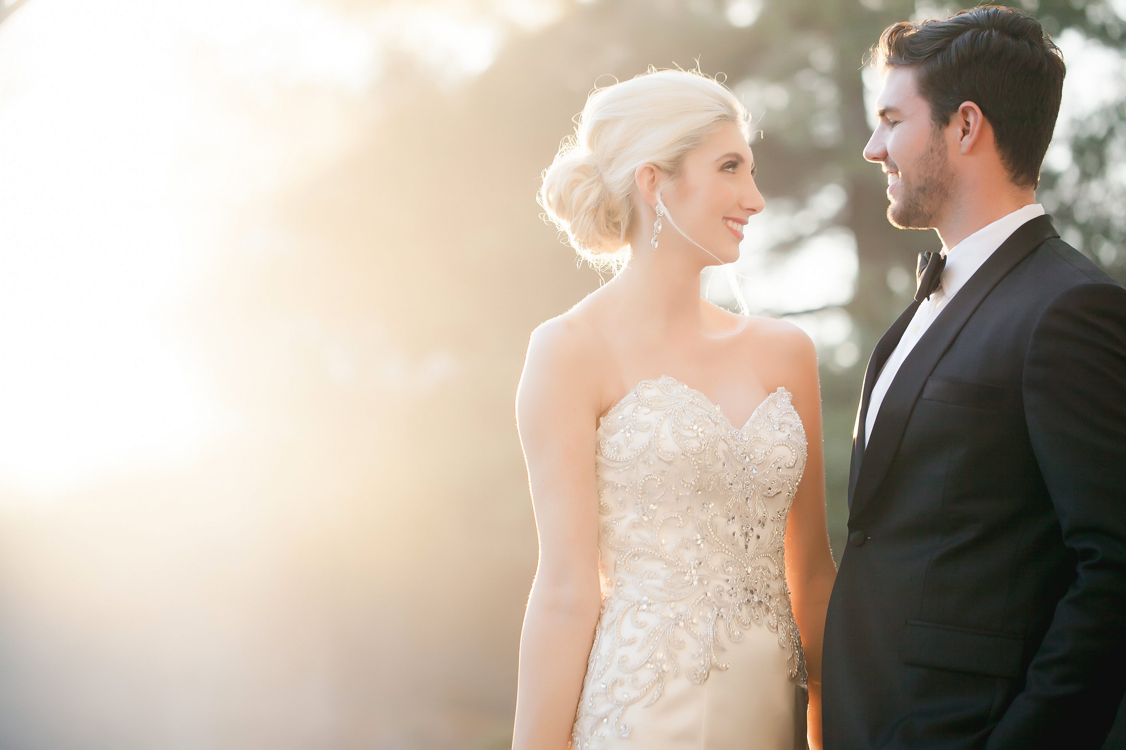 Bride wearing stunning embellished wedding gown from Paige and Elliot