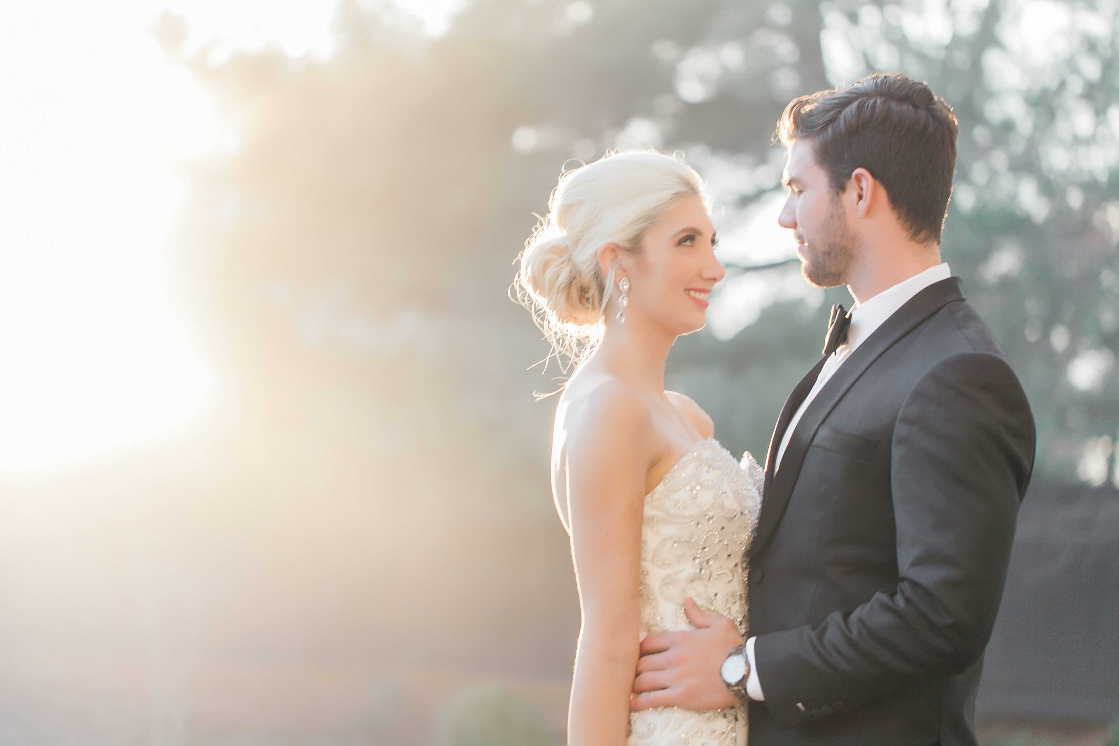 Bride and groom embrace before wedding at the Separk Mansion captured by Casey Hendrickson Photography