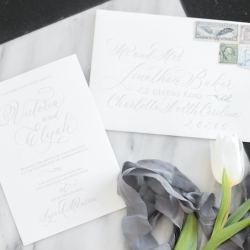 White and gray invitation suite created by Delighted Calligraphy for white and silver wedding at Separk Mansion