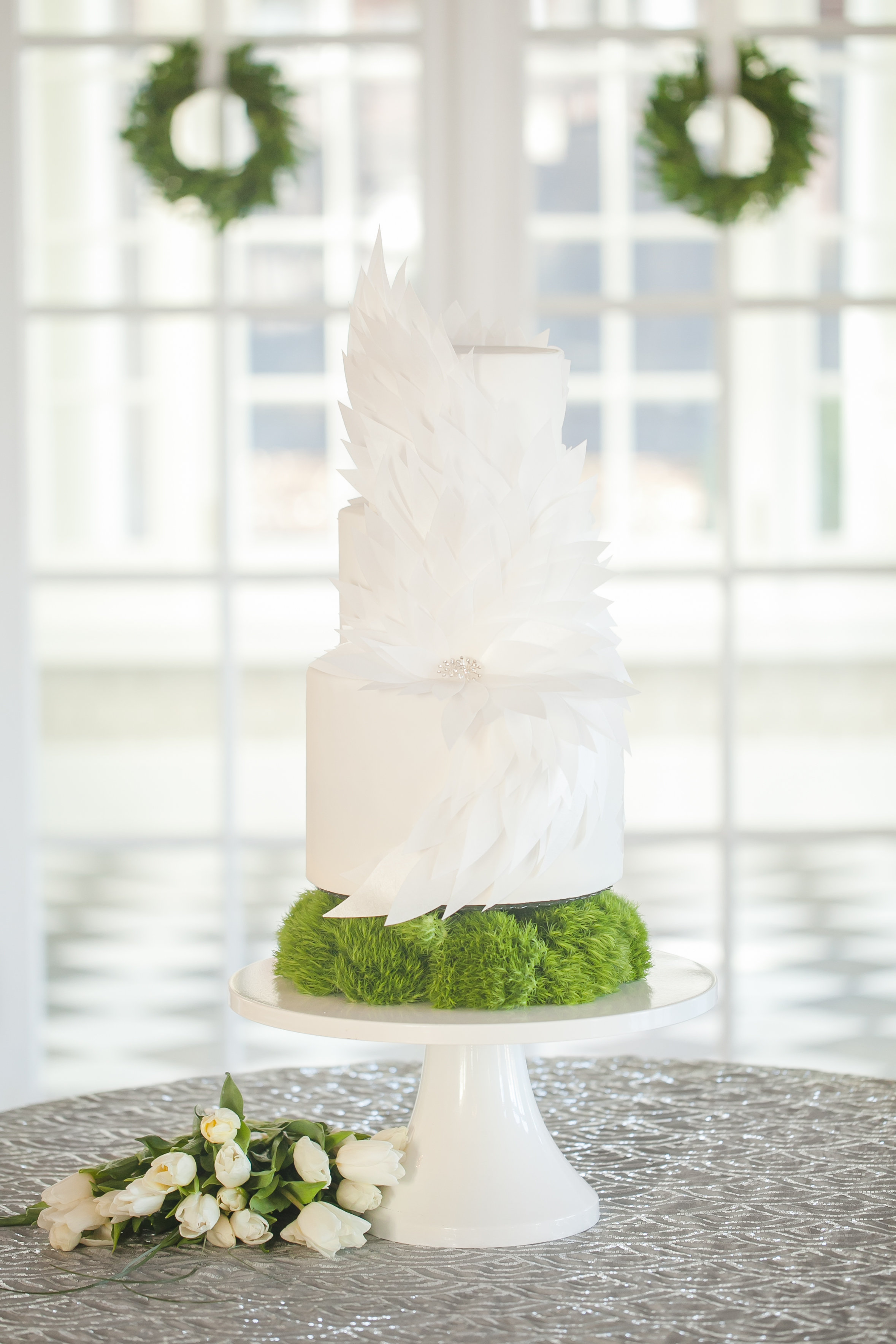 Three tier white wedding cake by Sky's the Limit Bridal Sweets for white and silver styled shoot at Separk Mansion