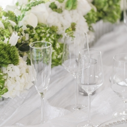 Stunning table setting for Separk Mansion wedding with white and green centerpiece designed by Chelish Moore