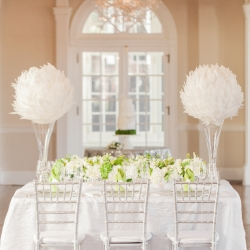 Amazing table setting at a Separk Mansion wedding with feather accents and pops of green captured by Casey Hendrickson Photography