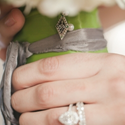 Detail shot of bridal jewelry and bouquet captured by Casey Hendrickson Photography