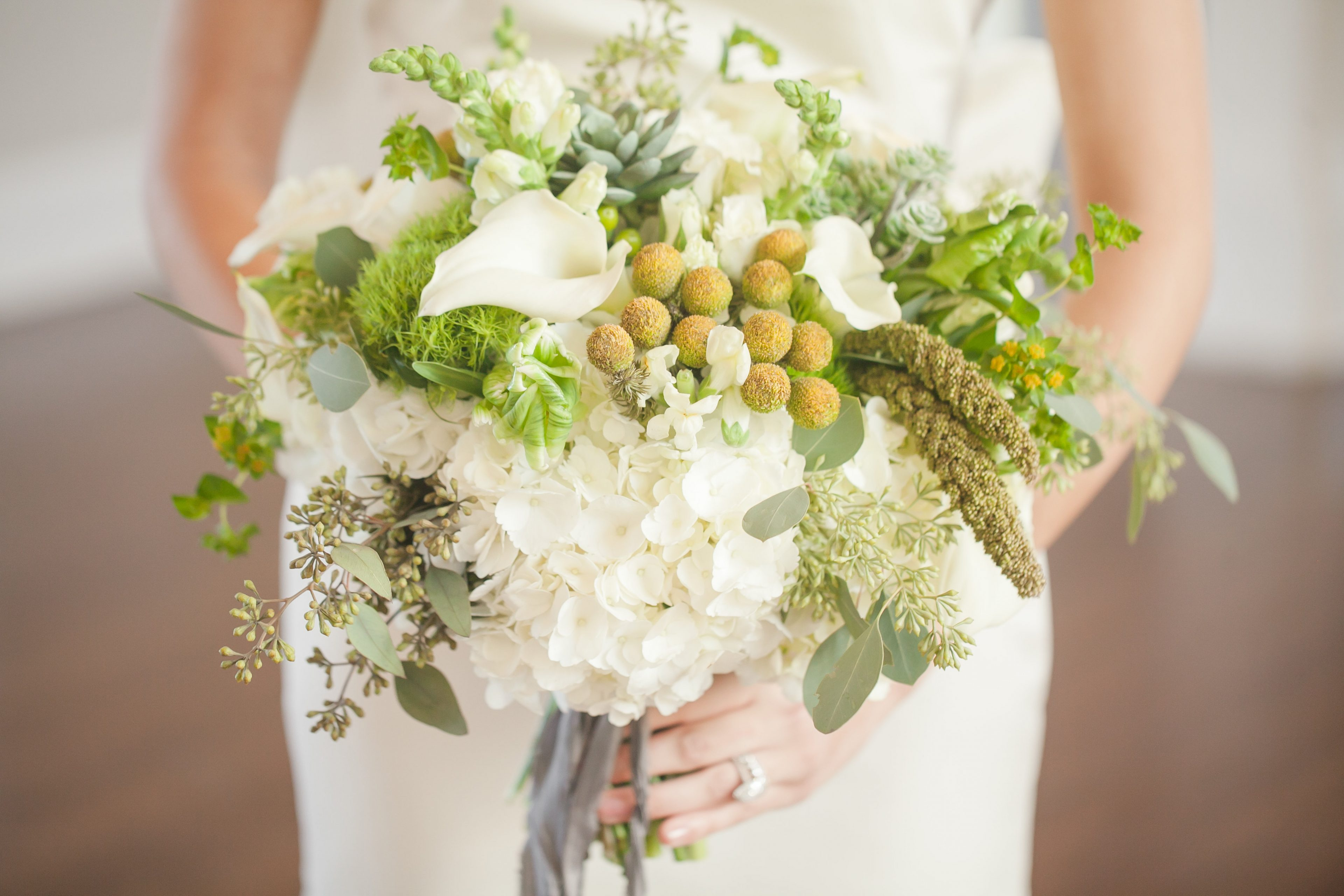 Amazing bridal bouquet with pops of green designed by Chelish Moore