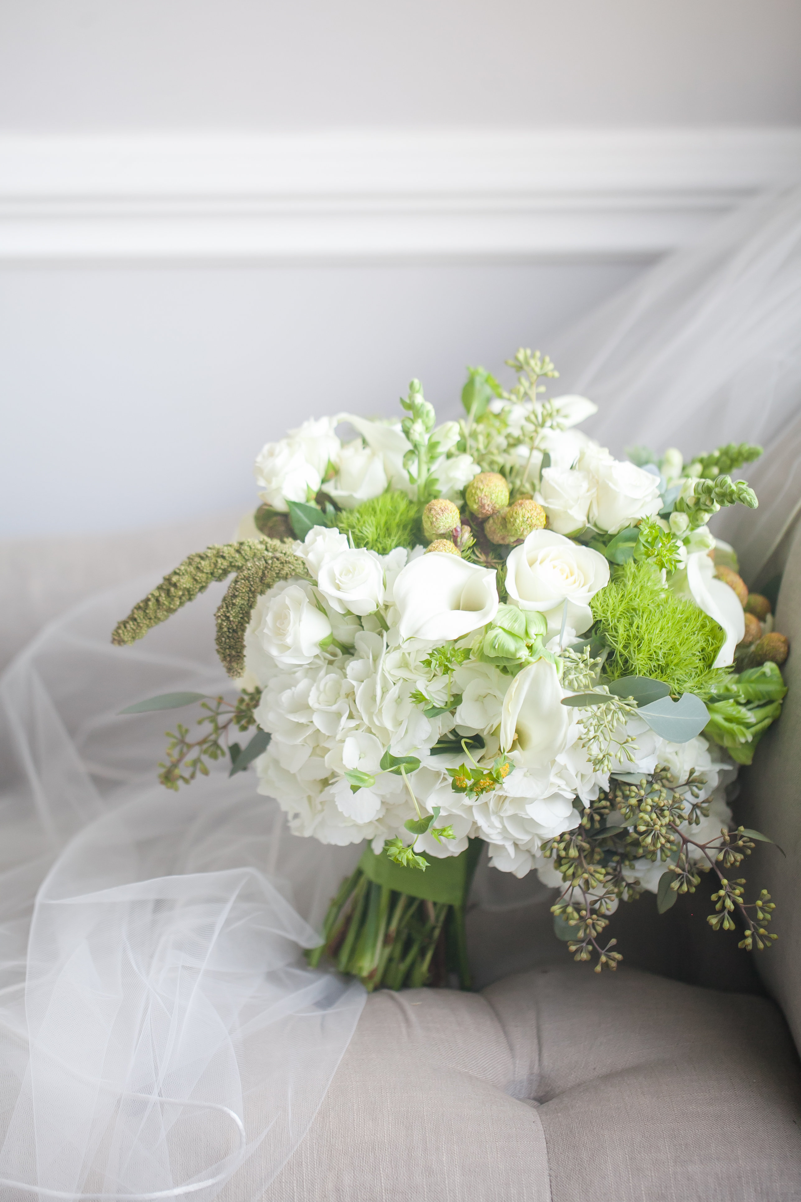 White bridal bouquet accented with pops of green for Separk Mansion wedding designed by Chelish Moore