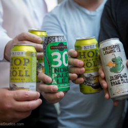 Groomsmen drinking Hop Drop and Roll beer while getting ready.