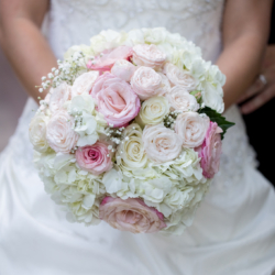 Bridal bouquet with blush and white roses by Magnificent Moments Weddings.