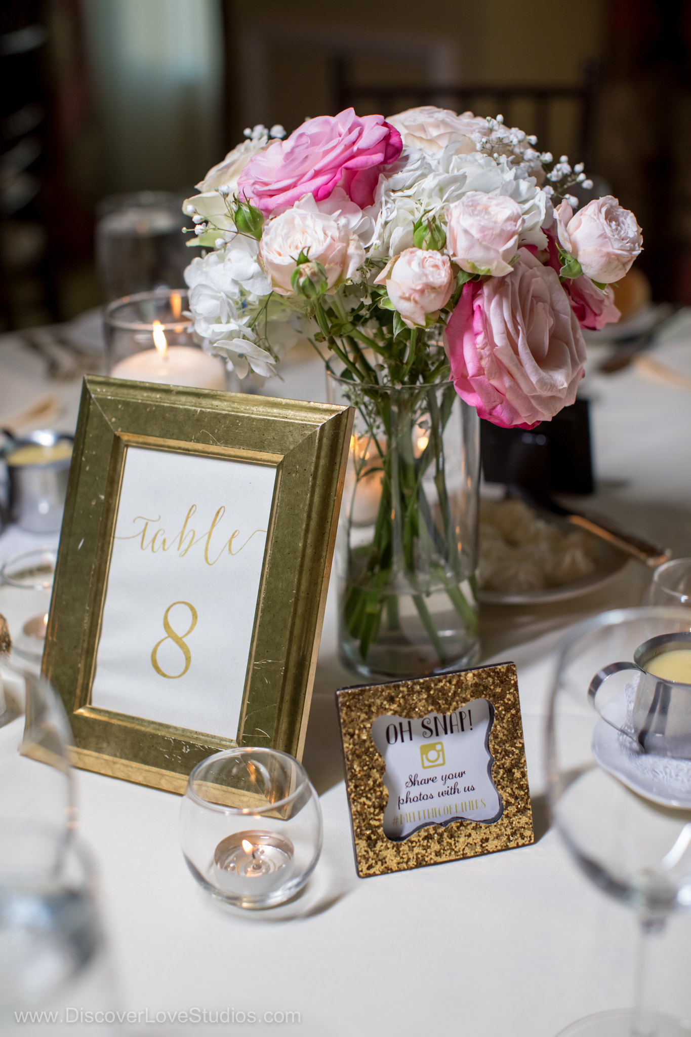 wedding table numbers with floral centerpiece