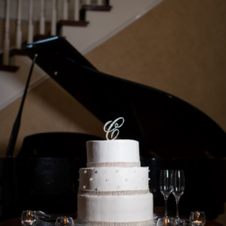 Wedding cake with piano background at the Charlotte City Club.
