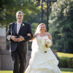 Bride walking down the aisle escorted by Dad.