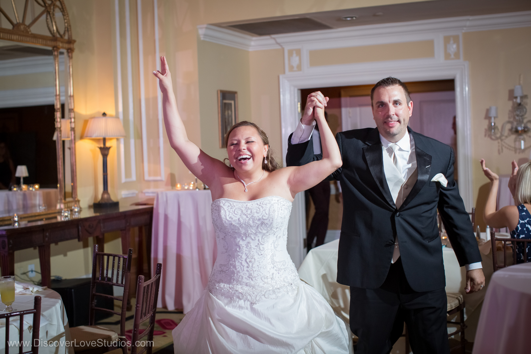 Bride and groom having fun at the Charlotte City Club.