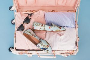 Perfect honeymoon suitcase packed using Magnificent Moments Weddings tips and tricks